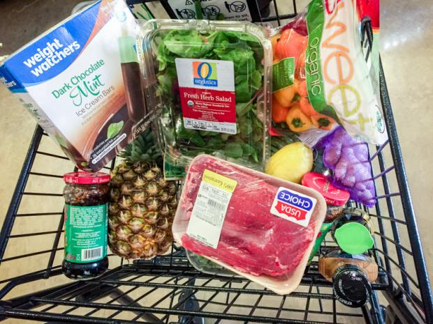 Picture from Reviews.com with a Shopping Trolley on a Weight Watchers day included lean meats, vegetables, and packaged Weight Watchers dark chocolate mint ice cream bars.